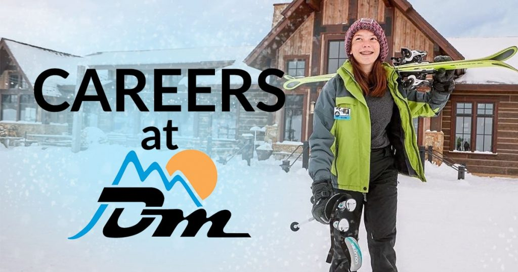 Careers at Detroit Mountain, smiling girl carrying skis to the slope near the lodge
